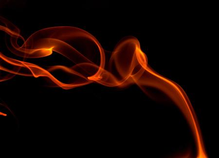 Orange smoke on black background Stock Photo