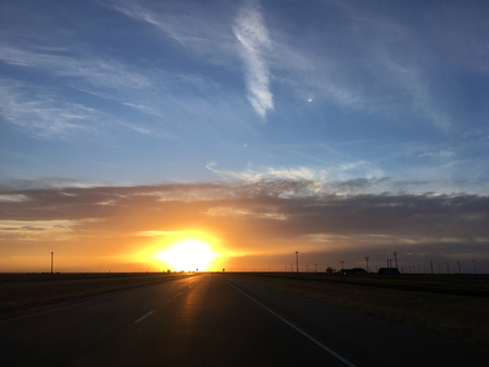 Road of the state of Texas in the United States at sunset