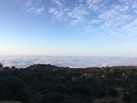 California landscapes nature background. Slowly filling clouds in the mountains. Fog