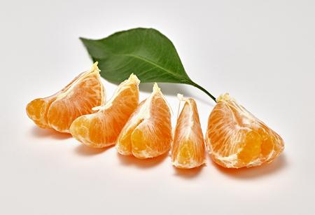 ripe tangerine on a white background. macro photography Stock Photo