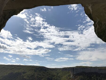 View of the mountains from the cave window. Cave city of ancient Christians Kachi Kalon. Фото со стока