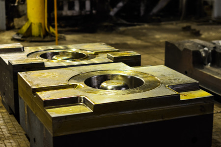High precision die mold for casting automotive aluminium parts make with iron metal steel by lathe milling drilling and CNC machinery in the industrial factory. Detail - form part of a cast machine. Stok Fotoğraf