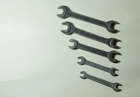 A set of metal nut wrenches for loosening-tightening bolts on a white background. Plumbing tool. Stock Photo