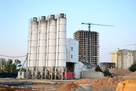 Stationary concrete batching plant on construction site. Producing сoncrete for construction and portland cement mortar. 写真素材