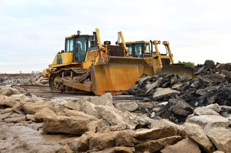 Track-type bulldozer, earth-moving equipment. Land clearing, grading, pool excavation, utility trenching, utility trenching and foundation digging during of large construction jobs. Crawler Dozers