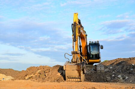 Excavator with crusher bucket for crushing concrete. Construction waste recycling for construction mix. Sifting and grinding bucket for the separation of concrete into fractions of higher quality. Stock Photo