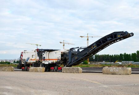 Cold milling machines are used for the quick, highly efficient removal of asphalt and concrete pavements. Removing and grinding the road surface, road construction and road rehabilitation - Image
