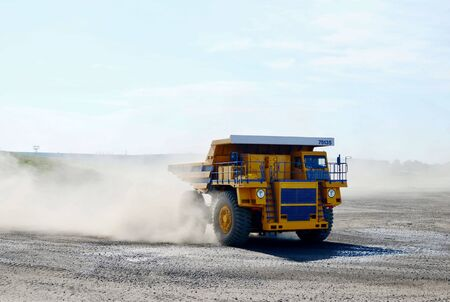 Giant mining dump truck, after being discharged from the conveyor, is tested at the factory test site. Heavy-duty truck manufacture by the heavy vehicle plant. 版權商用圖片
