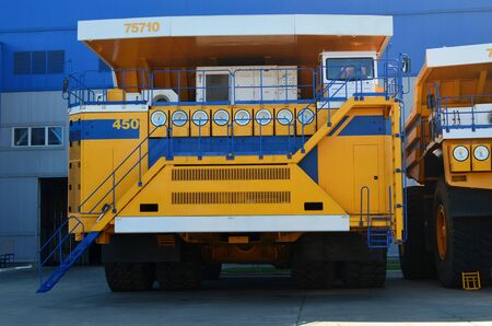 The worlds biggest truck with electric drive system consisting of four electric motors. Mining two-axle all-wheel-drive dump truck with weight-carrying capacity of 450 metric tons
