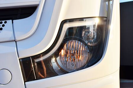 Frontal lighting products for on-highway vehicles, which includes integrated daytime running lights and beam patterns. Bi-Xenon and halogen headlamp of a modern truck, background texture - Image Imagens - 137091888