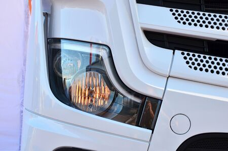 Frontal lighting products for on-highway vehicles, which includes integrated daytime running lights and beam patterns. Bi-Xenon and halogen headlamp of a modern truck, background texture - Image Imagens - 137092003