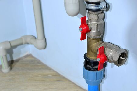Piping and plumbing fitting in the home industry of the modern era. Connecting pipe warm water floor to the manifold heating. Plumbing Pipes and Fixtures.