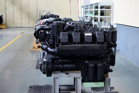 Large new diesel engines with turbines in the workshop of the factory for the production of trucks. Car's motor. Warning, small roughness sharpness, possible granularity.