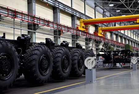 Super heavy duty machine with more wheels for ballistic missile transport and non-standard cargo. Industrial workshop for the production of military trucks, wheel chassis and vehicles 免版税图像