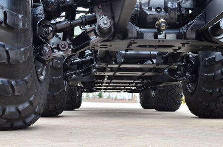 Lightweight fixed frame air suspension, air springs and shock absorbers on wheels with tyres. Truck suspension and steering linkage. Industrial workshop for the production of trucks and wheel chassis