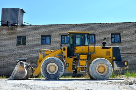 View of diesel wheel loader bulldozer with bucket on a construction site