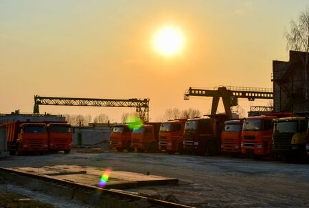 Truck parking at the construction site at sunset background