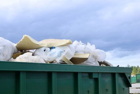 Skip for dumping renovation waste. Metal tanks and capacities for storage and transportation of garbage. Metal trash cans and containers for MSW.