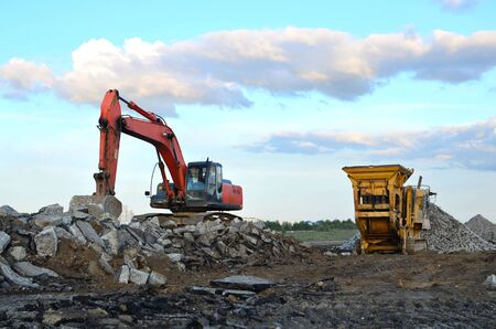 Mobile Stone crusher machine by the construction site or mining quarry for crushing old concrete slabs into gravel and subsequent cement production