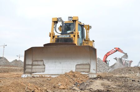 08.11.2019 Minsk, Belarus: Track-type bulldozer CATERPILLAR D6T , earth-moving equipment background Publikacyjne