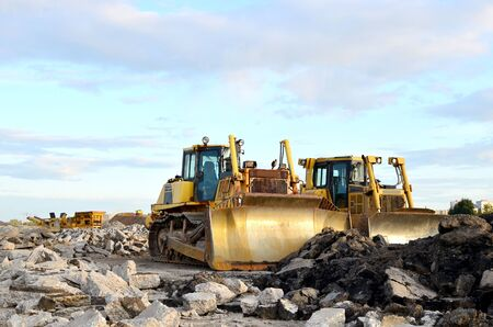 Track-type bulldozer, earth-moving equipment. Land clearing, grading, pool excavation, utility trenching, utility trenching and foundation digging during of large construction jobs. 版權商用圖片