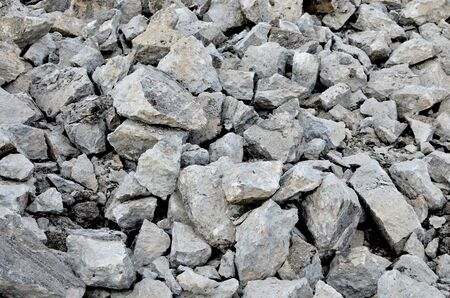 Broken pieces of asphalt at a construction site. Recycling and reuse crushed concrete rubble, asphalt, building material, blocks. Crushed �oncrete Background. Road repair, replacement of old pavement Banque d'images - 140989444