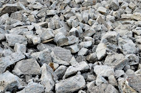 Broken pieces of asphalt at a construction site. Recycling and reuse crushed concrete rubble, asphalt, building material, blocks. Crushed �oncrete Background. Road repair, replacement of old pavement Banque d'images - 140989323