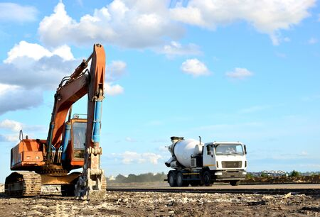 Excavator with hydraulic shears breaks asphalt on a construction site. Hydraulic shear crusher pulverizer for excavator. Heavy-duty mechanical concrete crusher. Attachments Equipment - Image