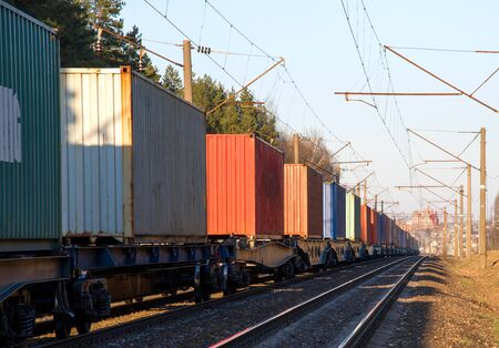 Cargo containers transportation on freight train by railway. Coronavirus Wreaks Havoc On Global Industry. Global economy is heading into a recession thanks to the widening fallout from the COVID-19