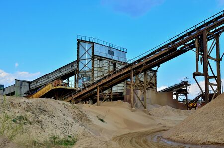 Sand making plant in mining quarry. Crushing factory with production line for crushing, grinding stone, sorting sand and bulk materials. Sand washing for the construction industry