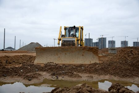 Track-type dozer for pool excavation and utility trenching. Bulldozer during land clearing and foundation digging. Earth-moving heavy equipment at construction site. Digger for road construction Zdjęcie Seryjne
