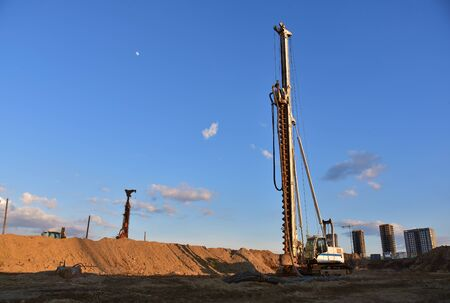 Vertical tamrock pile foundation drilling machine. Drill rig at construction site. Ground Improvement techniques, vibroflotation probe. Vibro compaction method. Piling Contractors