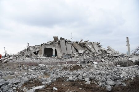 View of the demolition of a multi-storey building. Dismantling and demolition of buildings and structures. Destroy concrete