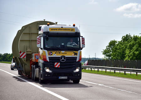 BELARUS - JUNE 07, 2020: Heavy duty tractor unit with push-pull Mercedes-Benz Actros MP4 2551 by ZTE RADOM Sp. z o.o.. Logistics of transportation of heavy and oversized cargo by road Editorial