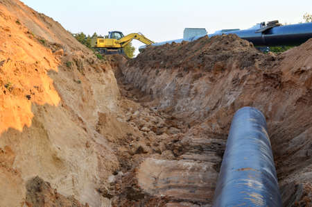 Ð¡onstructing pipelines that transport oil, natural gas, petroleum products and industrial gases. A dug trench in the ground for the installation of industrial gas and crude pipes.