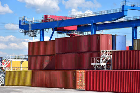 International Container Terminal. Cargo sea containers in port for shipping. Import - export goods from China. Shipping Containers Transportation, Logistics Concept.