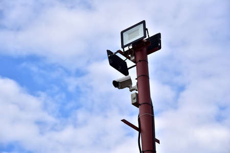 Video Surveillance. Video Camera on side post against a blue sky background. Security concept, forbidden territory, entry and entry prohibited. Residential CCTV systems Archivio Fotografico
