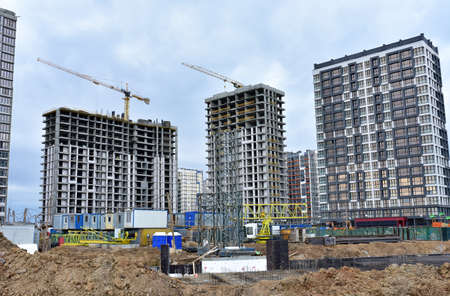 View of the larger construction site. Construction of multi-storey residential buildings. Tower crane installation
