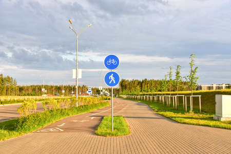 Footpath and bicycle path sign in city at pedestrian zone. Roadsafety concept.