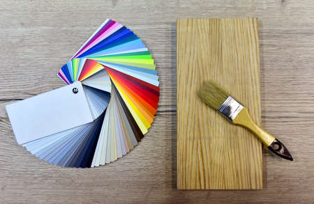 Color palette swatches with paint brush. Palette of different colors and shades on white background. Color catalog for tinting facade and interior paints, painting and for wooden facades in furniture