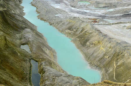 View of the turquoise water of the river among the canyon with mountains and rocks at Krasnoselsky village in the Belarus. Industrial mining quarry for the extraction of chalk for use in industry