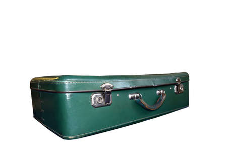 Old vintage suitcase isolated on white background. Green classic travel bag with key. Retro travel briefcase from old days, worn from prolonged use. Transportation and storage of personal household