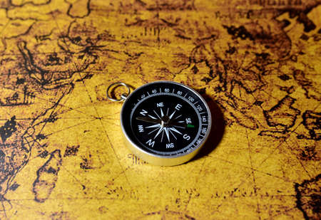 Compass on map. Tourist compass for orientation on the terrain. Magnetic declination сalculator. Historical explorer help. Map reading and land navigation concept. Orient on maps Stockfoto