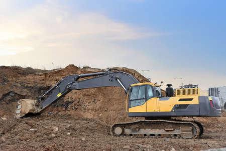 Excavator on earthworks at construction site