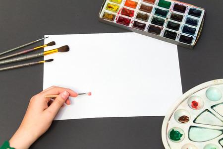 brush painting: painting brush on a white sheet