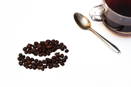 repose: cup of black coffee with roasted coffee beans on white background Stock Photo