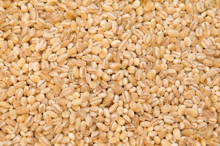 groats: Buckwheat is sprinkled  premium buckwheat groats on white background