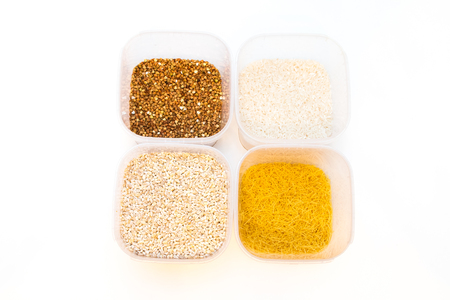 caloric: Buckwheat is sprinkled  premium buckwheat groats on white background