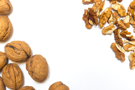 debris from walnuts on a white background