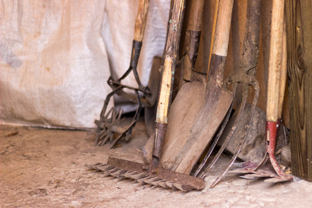 barn boots: Tools for agriculture are rustic garage, shovel, rake and the other garden items